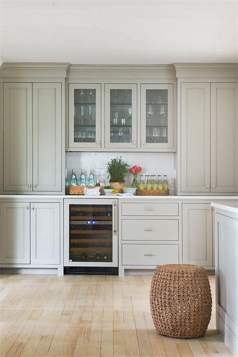 light gray shaker pantry cabinets  glossy white subway
