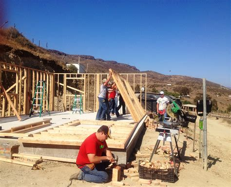 who builds houses pella mission workers return home from mexico after