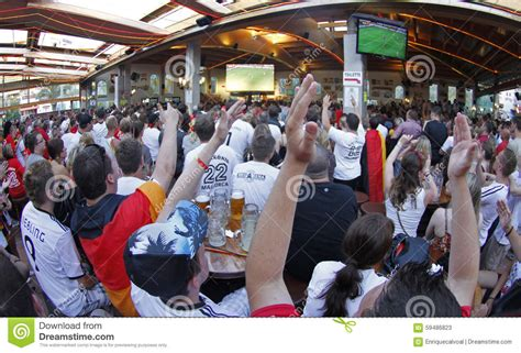 type of sport that fans watch on tv on thanksgiving german fans watching sports on tv royalty free stock photo