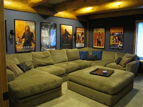 movie room sofa home theater room with a big couch and our movie posters
