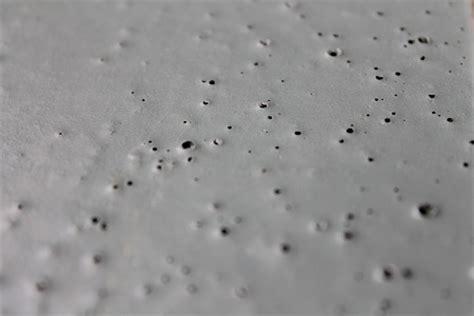 Are Those Pin Holes in My Floor?   Milamar Coatings LLC