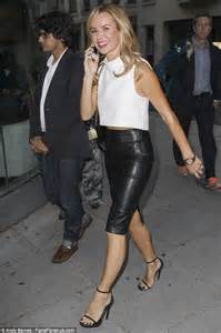 amanda holden shows toned legs in leather