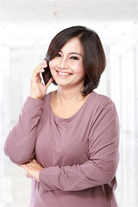 japanese middle age women pretty asian middle aged woman on the phone stock photo