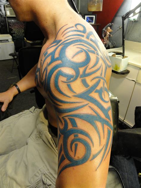 shoulder to arm tattoo designs 69 traditional tribal shoulder tattoos
