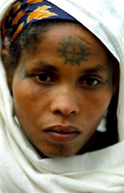 ethiopian tribal tattoos africa with a cross tattooed on