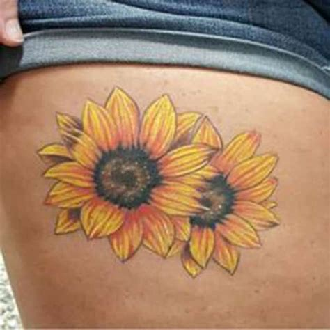 sunflower thigh tattoo 20 unique sunflower tattoos and their mysteries inkdoneright