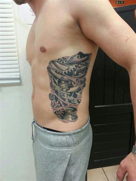 on ribs gears ripped skin thru skin tattoos pinterest