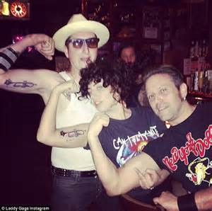 lady gaga gets trumpet tattoo on her upper arm after