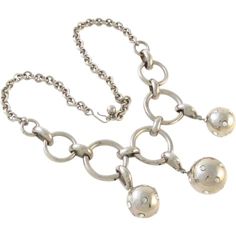 bold vintage silver tone disco balls necklace from