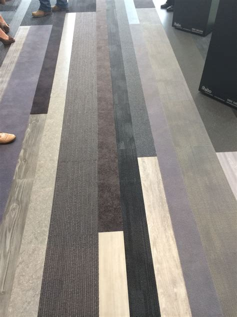corporate carpet vinyl planks and carpet tiles installed together to create