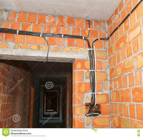 bricklayer building new house with brick walls interior