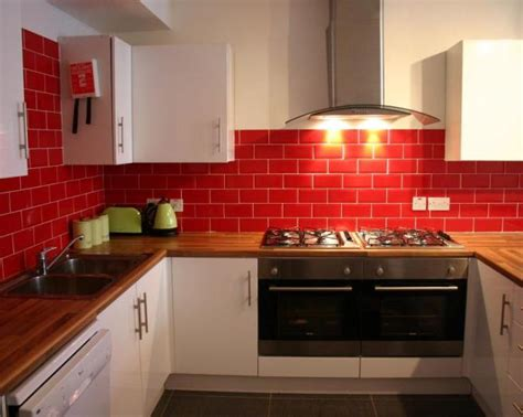 tiled kitchen ideas photo of red red tiled splashback kitchen with white