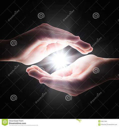 how to light your hand on fire cross light in the darkness in your hands stock photo