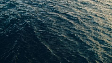 4k relaxing blue digital waves moving background 2160p 60fps beautiful slow motion ocean surface quietly waving a wave