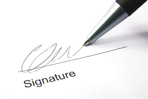 Signature by Detail View Of The Signature Box Of A Contract With A Pen