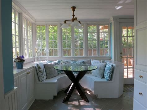 Cottage Dining Room with Built in bookshelf & Chandelier