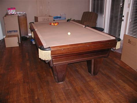 used tables input on a used brunswick heritage pool table