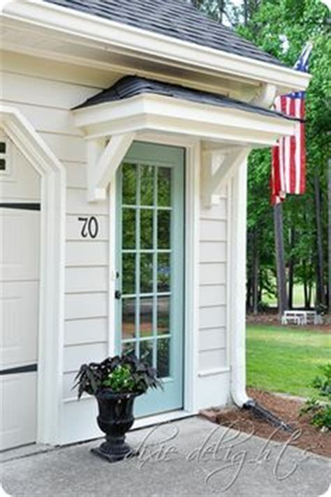 small awning over back door house beautiful curb appeal and patio makeover on pinterest