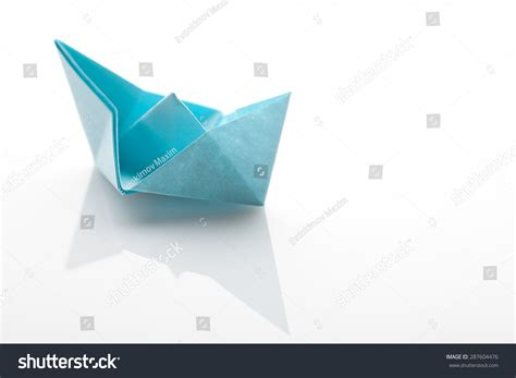 Origami Paper White - origami paper ship on white background stock photo