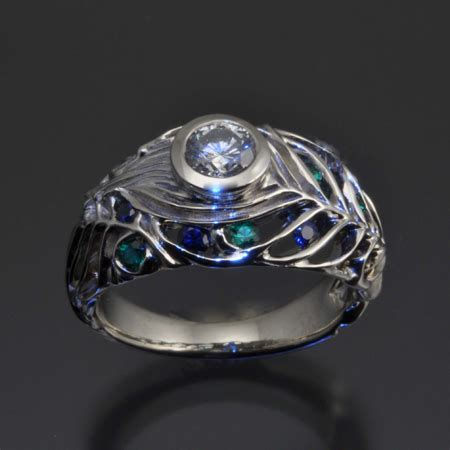 peacock ring with half carat sapphires and