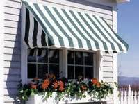 flower boxes shutters and awnings on window