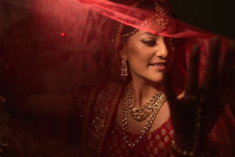 Indian bride in red lehenga with veil at the Beaumont Estate