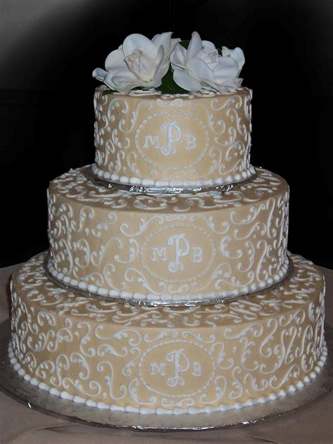 White On White Buttercream Scroll Chagne Gold Buttercream Iced 3 Tiered Wedding Cake