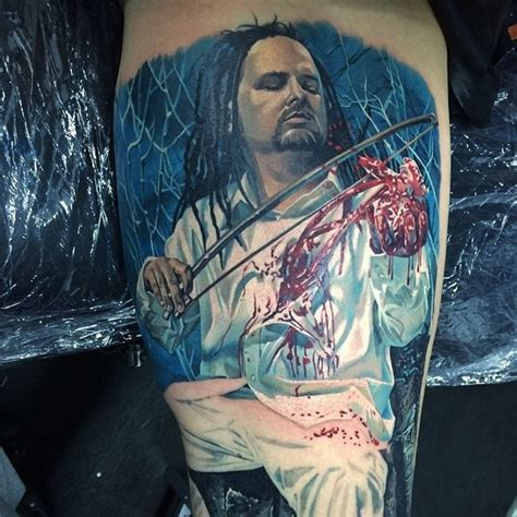 tattoo hand saw colored horror style biceps tattoo of man with bloody hand