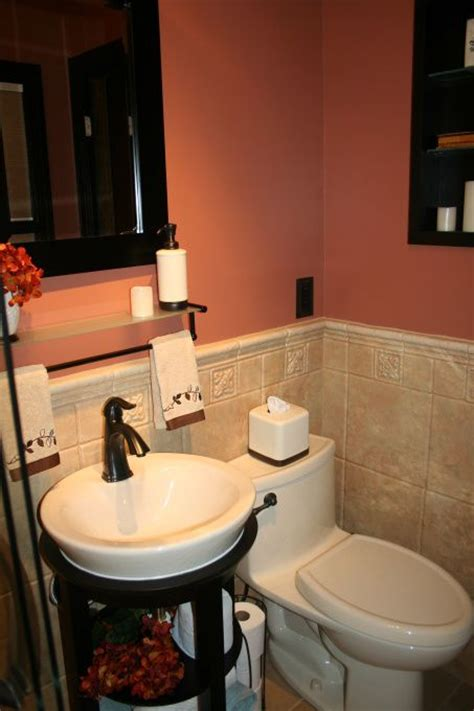 this coral paint color with the black and rubbed bronze accessories bathroom ideas