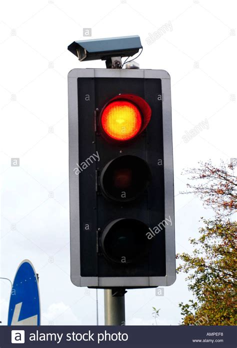 cameras on top of lights traffic light with cctv stock photo royalty free