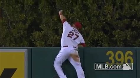 mike trout skies way above the wall to rob a home run with