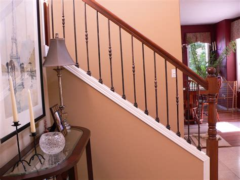 rod iron banister oil rubbed wrought iron balusters restained post handrail portland stair company