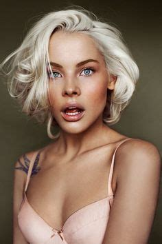 bleach blonde hair on tan skin tattoos on pinterest swallows rose tattoos and sparrow