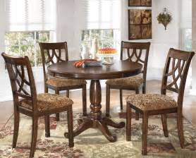 Leahlyn solid wood dining set with pedestal round table