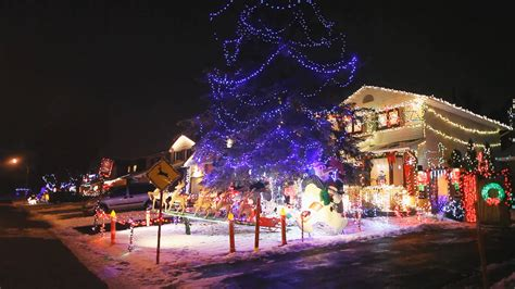 ground christmas lights a of homes at with colourful lights snow on the ground stock