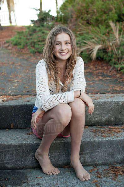 barefoot girl sitting  park steps stock photo dissolve