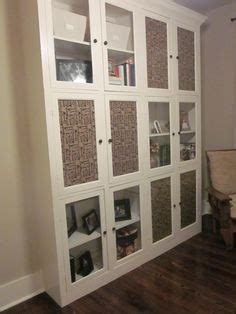 covering glass cabinet doors with fabric 1000 images about storage on pinterest wall cabinets