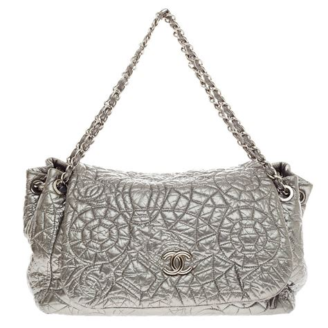 Preowned Authentic Chanel Silver Patent Vinyl Camellia Flap Bag chanel graphic edge flap patent vinyl xl at 1stdibs
