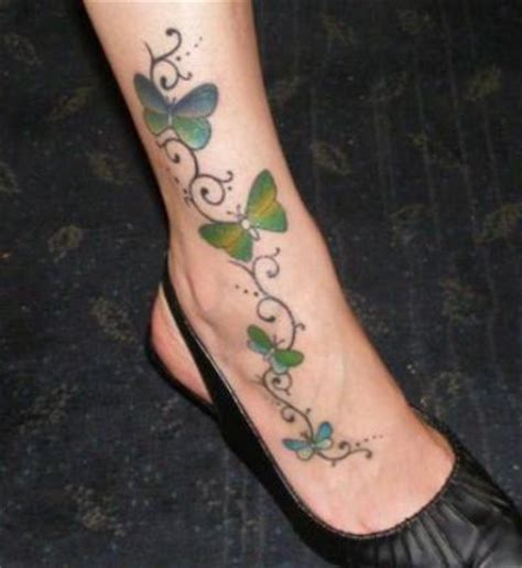 butterfly tattoo with vines and flowers butterflies vine tattoo