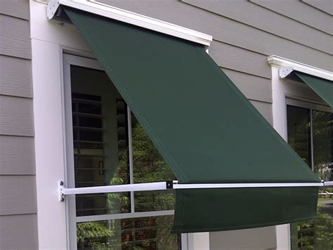 retractable window awnings window awning red house with window awning made using grey sunbrella fabric