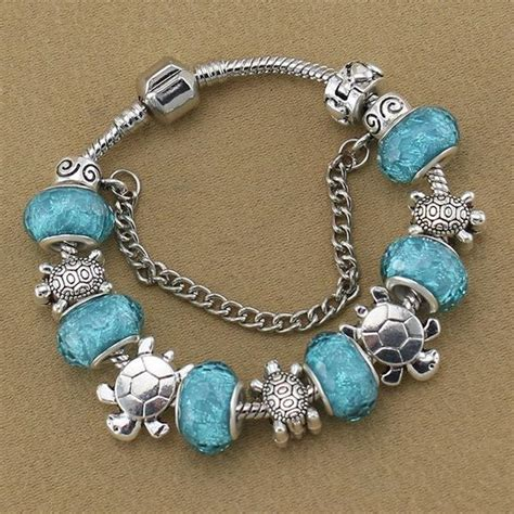 Handmade Charm - blue handmade sea turtle charm bracelet helping animals