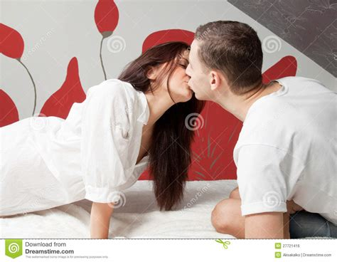 kiss in bed woman and man kissing www imgkid com the image kid has it