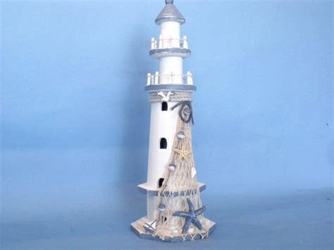 decorative lighthouses for in home use wooden white lighthouse with shells 16 quot decorative