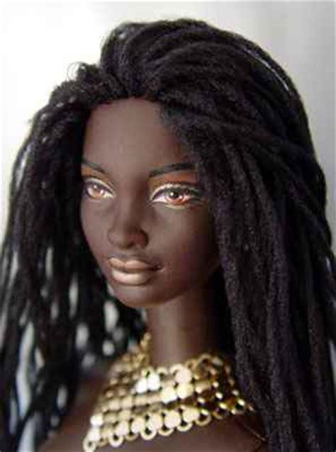 black doll on bed black locked politics of black hair