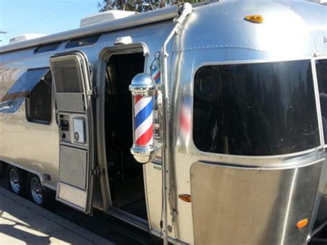 haircut trailer austin lava salon owner pushing mobile barber shop bill