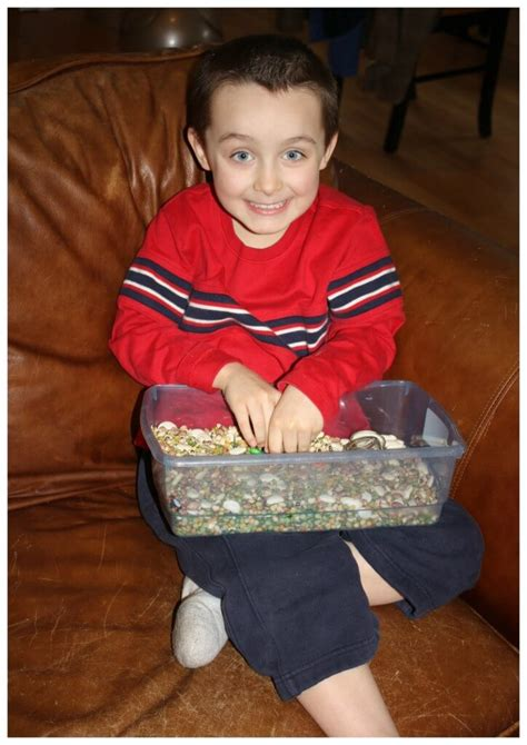boy on couch calming sensory bin for kids little bins for little hands