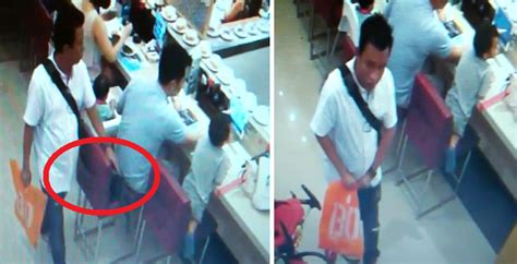 Cctv In Malaysia cctv footage in malaysian store shows how shockingly easy it is to from someone world of