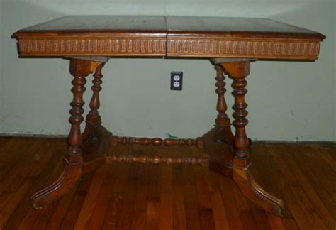 antique oak dining room table w leaves four