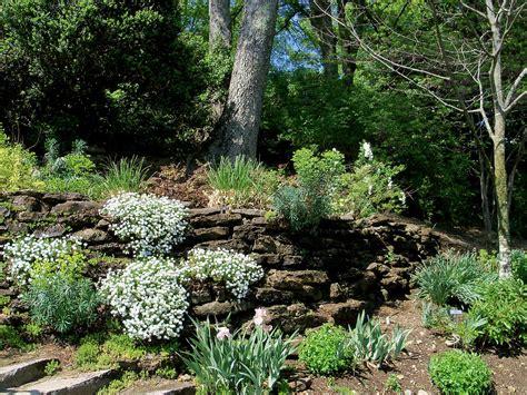 garden rock wall garden with rock wall photograph by donna melton