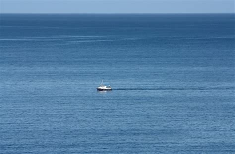 small boat big ocean free stock photos rgbstock free stock images big sea